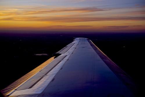 sunset reflection clouds airplane twilight nebraska wing omaha sonya7 fe5518za
