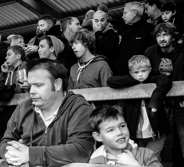 Faces in a crowd. Bristol Rovers fans at football game.