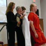 CON Scottsbluff - Zachary Swift  bends down so that Wendy Wells, BS, RN, MSN, Nursing Instructor can put his coat on him