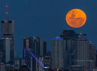 QANTASlink Dash-8 crossing the Full Moon behing Brisbane city | by mudge.stephen