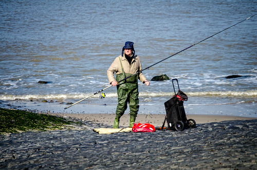 Fisherman Wear Funny Hats and Rubber Pants