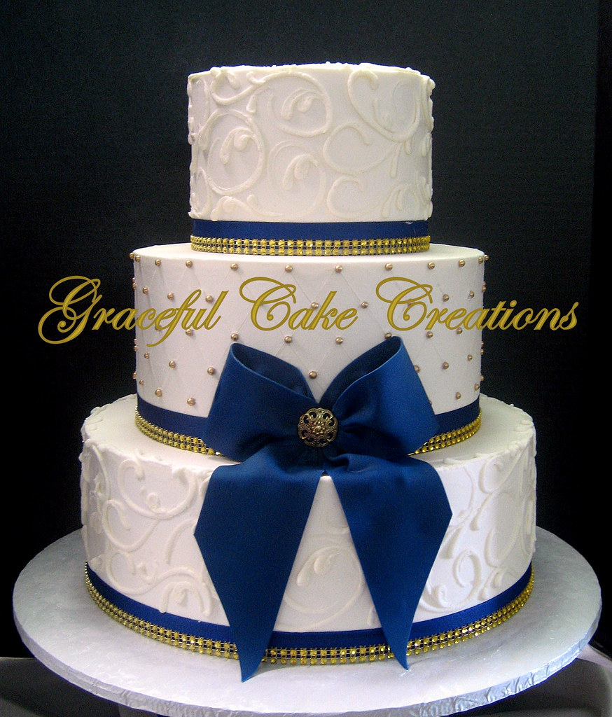 Elegant Ivory Butter Cream Wedding Cake With Gold Sugar Pe
