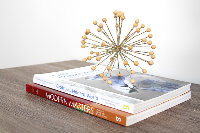 Coffee table books with gold orb