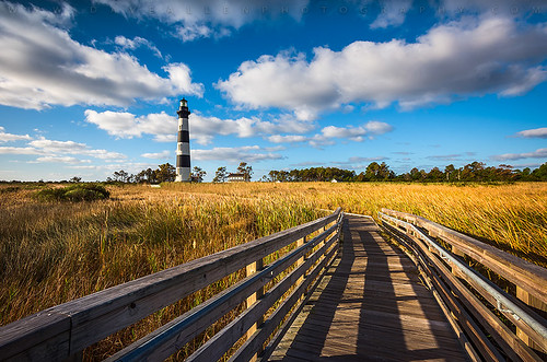 northcarolina obx outerbanks nc bodie lighthouse capehatteras bodieislandlighthouse nagshead seashore nationalseashore landscape scenic clouds bluesky grasslands marsh light coast coastal atlantic eastcoast outdoors beach national usa america