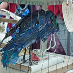 Crow paper sculpture left in honour of Iain Banks' The Crow Road |