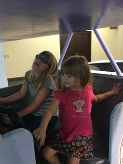 Flying an airplane at the kids' museum.   by poobou