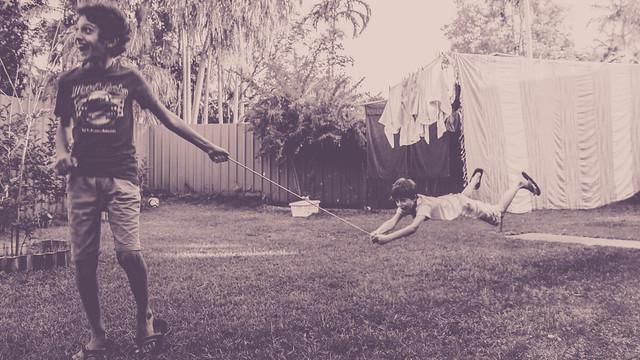 Kids playing at the back yard (Levitation)