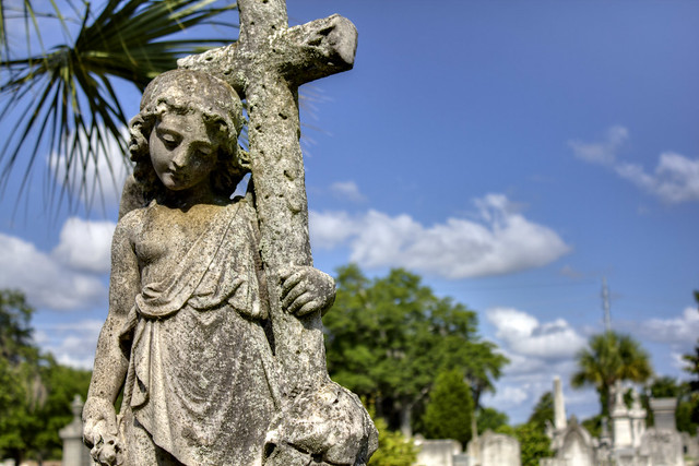 Female with cross statue, Magnolia Cemetery, Charleston, SC