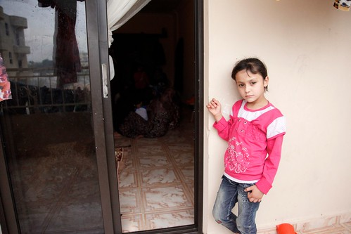 A girl waits outside a gender-based violence support session for Syrian refugee women in Lebanon | by DFID - UK Department for International Development