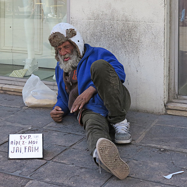 The real beggar is back to his place