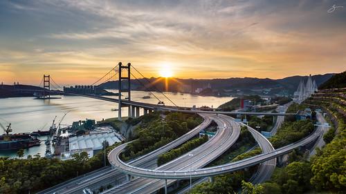 bridge sunset clouds canon landscape hongkong cityscape sunstar