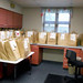 Bags ready for delivery by the Outreach Services Department  On Monday, July 13, 2015, State Librarian Beverly Cain and Bill Morris visited the Public Library of Mount Vernon and Knox County.