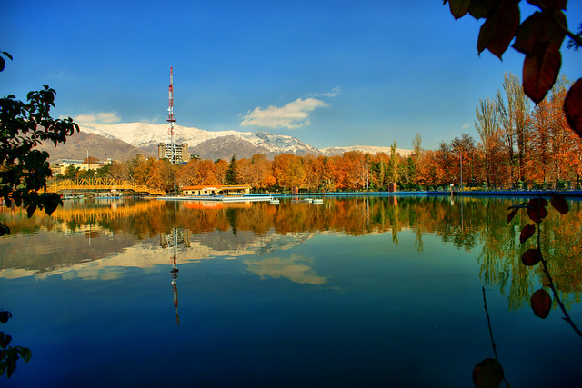 Mellat Park Lake and Snowy Alborz Mountains in Fall, Tehran, Iran (Persia)