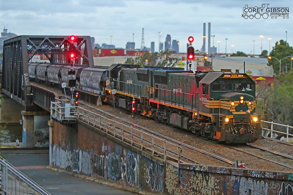 XR554 & XR552 depart Dynon with an evening empty grain service by Corey Gibson