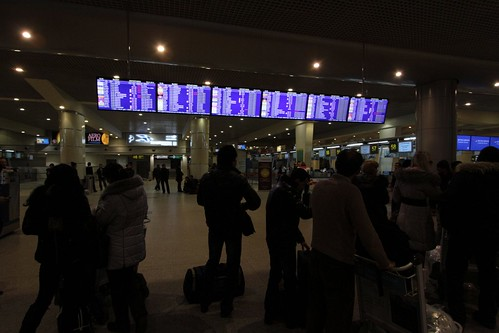 Waiting in front the airport departure boards