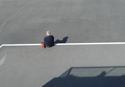 square waiting figure solitary streetview lookingout oneman vividstriking