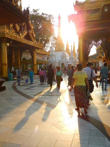 worshippers wandering around the Golden Shwedagon Pagoda in Yangon, Myanmar