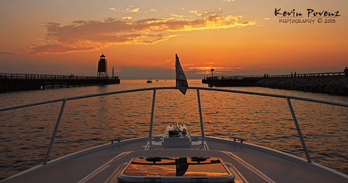 sunset orange sun reflection water yellow evening pier boat kevin dusk michigan july july4th lighhouse charlevoix 2013 povenz