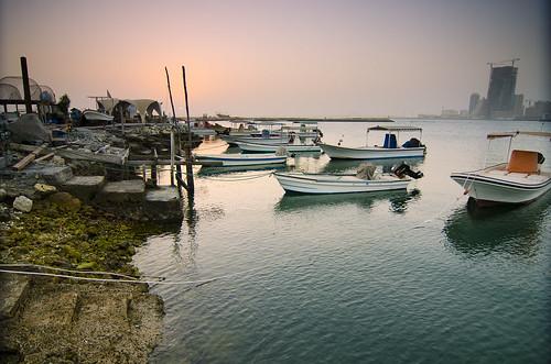 city travel sunset sky water sunrise boats photography bahrain fishing industrial east middle trespassing manama