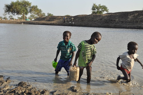 Children collecting water from a haffir | by Oxfam East Africa