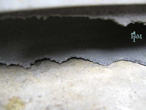 Photo shows a c0loseup of a rubber gasket with a jagged edge from indentations made by tooth impressions.
