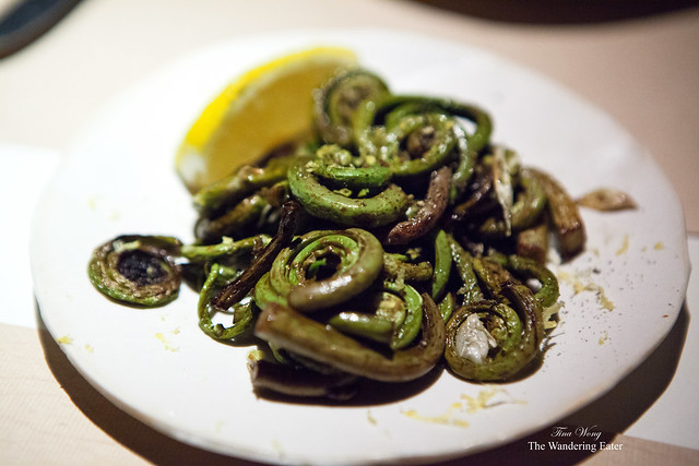 Wood oven roasted fiddlehead ferns with spring garlic and lemon