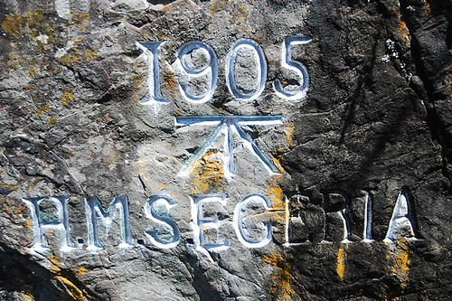 Carving left by the British Survey Ship HMS Egeria, Poets Cove, Pender Islands, British Columbia