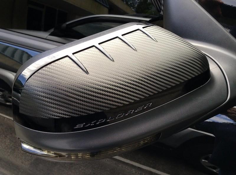 Carbon fiber wrapped car mirror
