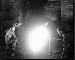 05. Foundrymen tapping out furnace at 17th and Hull Street foundry.  1930 to 1940?
