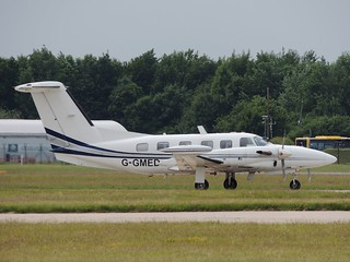 Piper PA-42-720 G-GMED arriving at Manchester, 17 June 2013