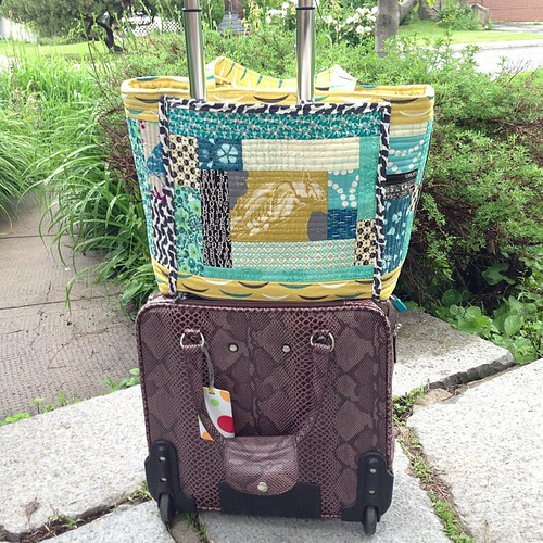 Back has pocket with zipper on the bottom to slide over roller bag handles | by Stitchliterate
