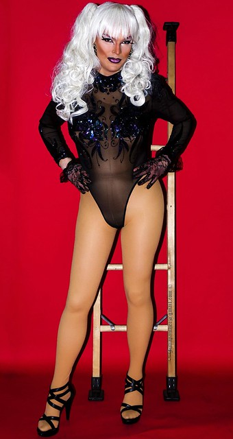 Gothic glamour barbie look in sheer bodysuit and pantyhose