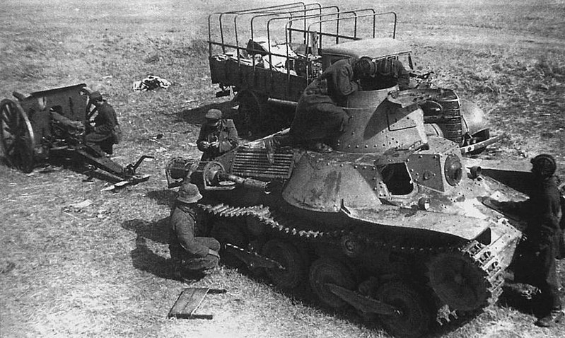 Soviet troops inspect a destroyed Type 95 Ha-Go light tan