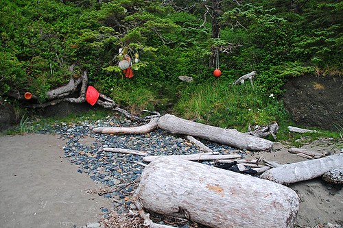 Trailhead markers on the beach at Raft Cove Provincial Park, West Coast Vancouver Island, British Columbia, Canada