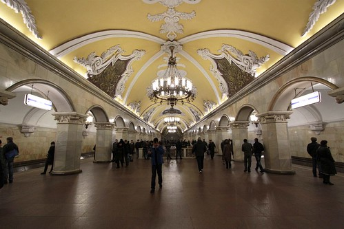 Ornately decorated central passage of the platform, with chandeliers above