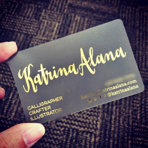 So happy with how my new business cards turned out. I couldn't wait to take them out at the office and share a photo. I love how the gold foil is complementing the opaque plastic card. So fancy! #branding #businesscard #goldfoil #logo #calligraphy #callig | by katrina.alana