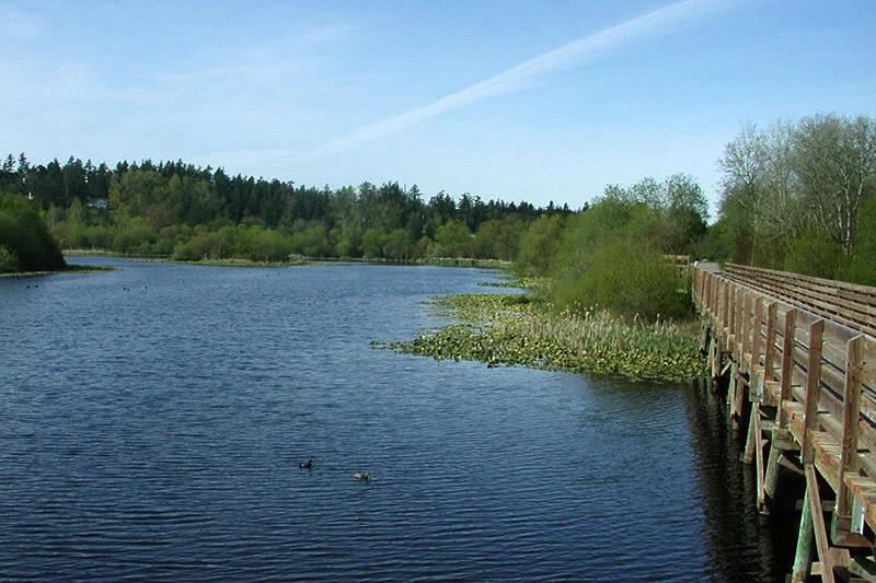 Lochside Trail crosses Blenkinsop Lake in Saanich, Greater Victoria, Vancouver Island, British Columbia