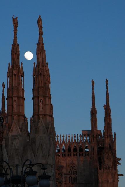 The moon gazing upon Milan Duomo pinnacles