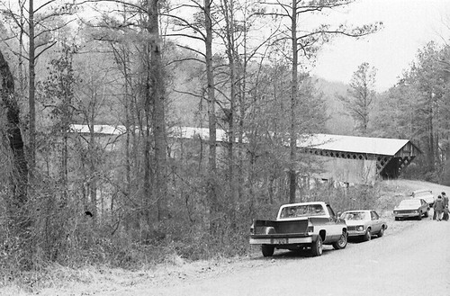 structures vehicles coveredbridges streetviews blountcountyalabama swanncoveredbridge nationalregisterofhistoricplaces blackwarriorriver stateofalabama circa1930s swannbridgeroad alabamalandmarks bridgesandtunnels stateroute79 clevelandalabama rolla057 locustforkoftheblackwarriorriver townlatticetrussconstruction alabamacleveland alabamacountyblount formatfilm35mmnegativebw year1983pictures cameracanonae1program2067283 canonae1program2067283