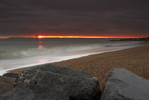 sunset sea seascape colour beach water clouds reflections coast rocks day waves cloudy hayling hampshire seaveiw
