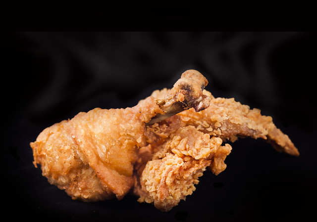 fried chicken wings isolated on black
