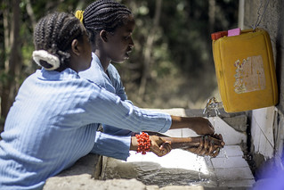 Female students wash their hands after using bathroom at Dima Guranda Primary School | by UNICEF Ethiopia