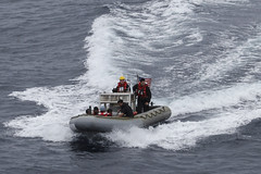 The crew of a rigid hull inflatable boat from USS Green Bay (LPD 20) returns to the ship June 19 after recovering Indonesians who were trapped on a raft at sea. (U.S. Navy photo)