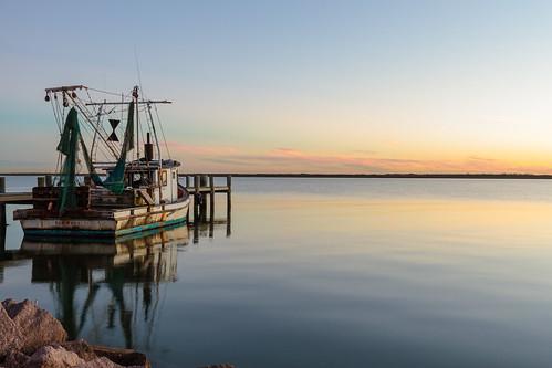 sunset galveston water bay boat texas jetty houston shrimp shore dike