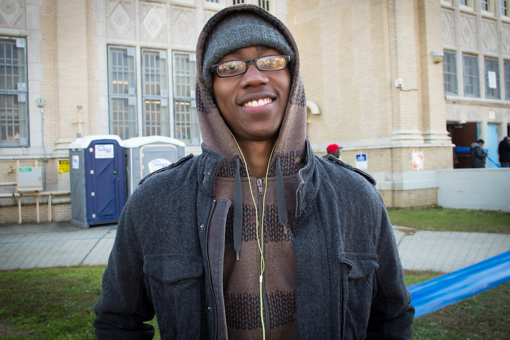 """""""I feel more American by voting"""" -I.K., a young voter outside of Far Rockaway High School."""