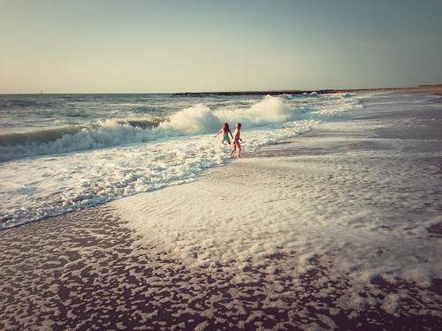 playing kids contrast denmark waves northsea westcoast vesterhavet thyborøn