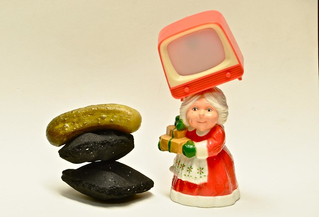 Mrs. Claus Still Life with Charcoal, a Pickle and a TV