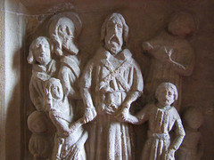 Priest marrying a couple as Christ looks on - seven sacrament font (detail)