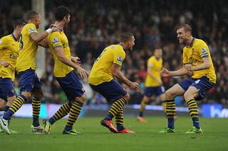 Lukas Podolski celebrates scoring his 1st goal