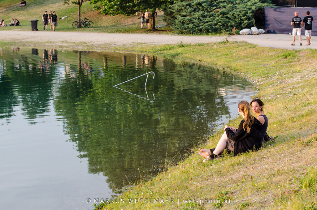 """Fans relaxing on the lakeshore of Schwarzl See at See Rock 2013 Festival near Graz, Styria, Austria on June 21, 2013.  © Markus Wetzlmayr   <a href=""""http://www.wet-photo"""" rel=""""noreferrer nofollow"""">www.wet-photo</a> NO USE WITHOUT PERMISSION."""